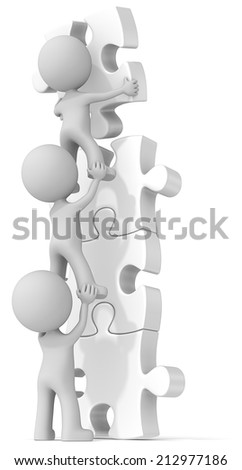 Team effort. The dude x 3 building white puzzle tower. - stock photo