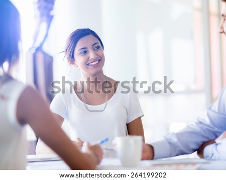 Team having a discussion in office - stock photo