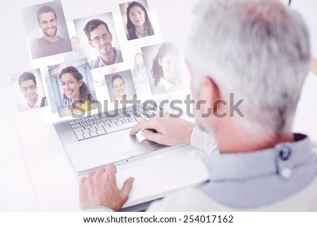 Team having meeting and smiling at camera against profile pictures - stock photo