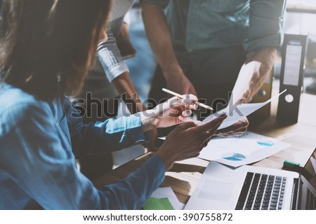 Team job succes. Photo young business managers  working with new startup project in office. Analyze document, plans. Generic design notebook on wood table, papers, documents. Horizontal, blurred - stock photo