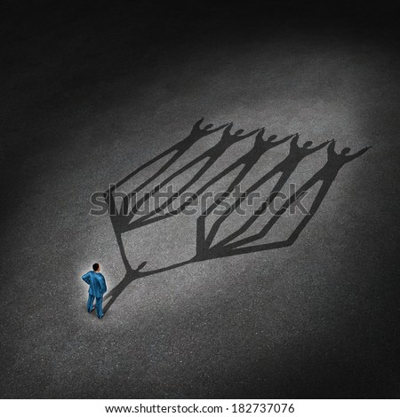 Team leadership and business leader concept with a businessman casting a shadow of a connected network group of employees and working partners as a metaphor for successful teamwork partnership . - stock photo