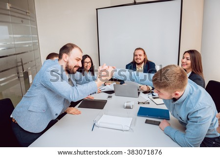 Team meeting. Discussion of business strategy. Handshake