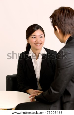 Team meeting in corporate setting - stock photo