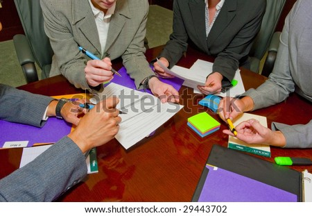 Team Meeting with Documents and Writing - stock photo