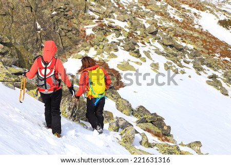 Team of alpine climbers carefully descending a snow covered mountain - stock photo