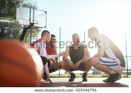 Team of basketball players making a break. - stock photo