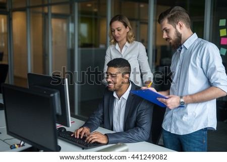 Team of business colleagues working together in an office. - stock photo