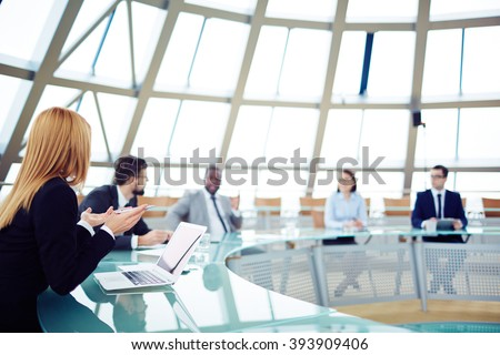 Team of business people discussing during a meeting - stock photo