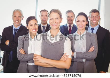 Team of businesspeople posing together in the office - stock photo