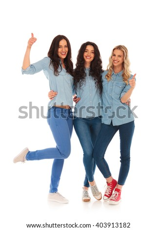 team of casual young women making the ok thumbs up sign on white background - stock photo
