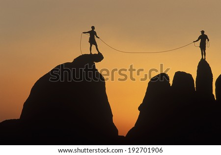 Team of climbers conquer the summit. - stock photo