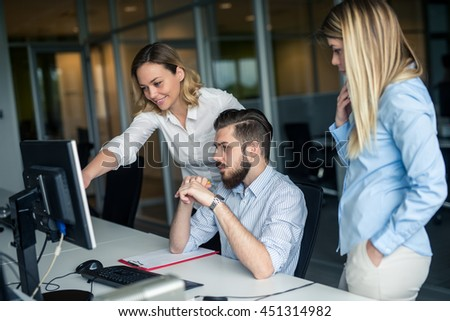 Team of colleagues working together in an office. - stock photo