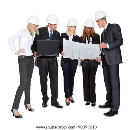 Team of confident architects studying blueprints on white background - stock photo