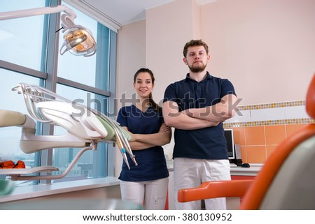 team of dentists before receiving visitors in a dental clinic