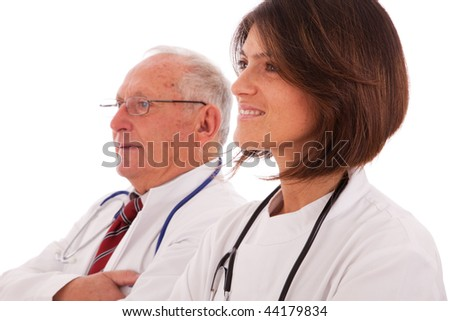 Team of doctors, with a older man and a young woman (isolated on white) - stock photo