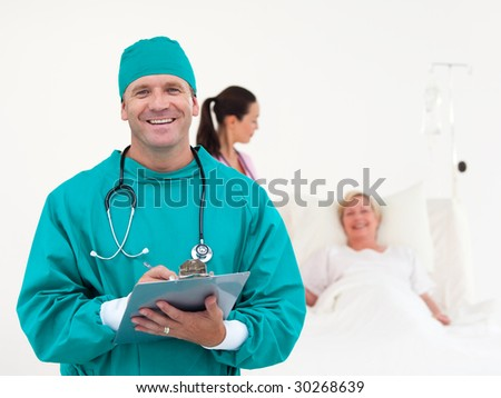 Team of Doctors working in a Hospital ward - stock photo