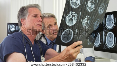 Team of doctors working in the office - stock photo