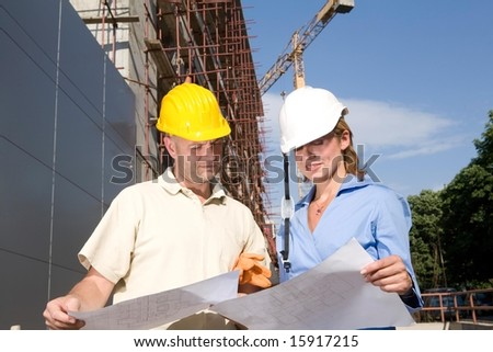 team of engineers at the construction site - stock photo