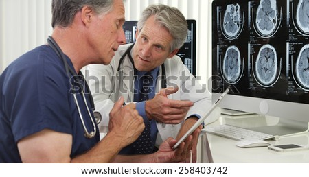 Team of experienced doctors working in the office - stock photo