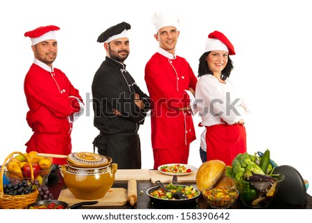 Team of four chefs standing with arms folded isolated onw hite background  - stock photo
