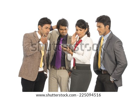Team of four sad Indian business people on a white background.  - stock photo