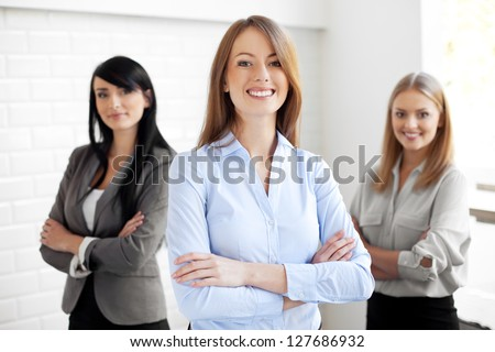 Team of happy businesswomen - stock photo
