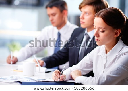 Team of office workers attending business training to improve the results of the work - stock photo