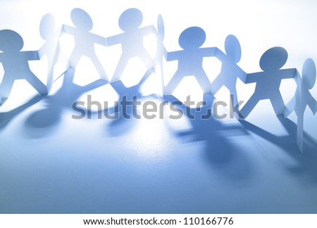 Team of paper doll people - stock photo