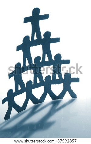 team of paper man showing concept of teamwork - stock photo