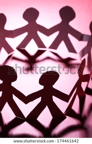 Team of paper people. Shallow DOF! - stock photo