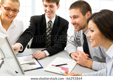 Team of people working in a office