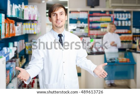 Team of pharmaceutist and european technician working in chemist shop