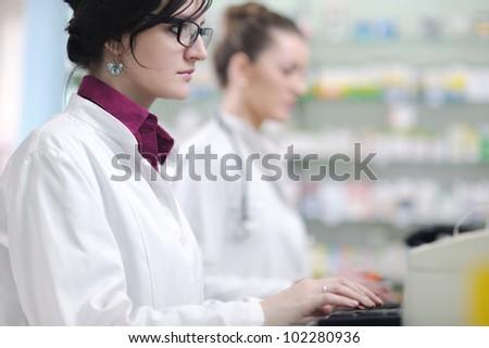 team of  pharmacist chemist woman group  standing in pharmacy drugstore - stock photo