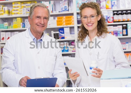 Team of pharmacists looking at camera at the hospital pharmacy