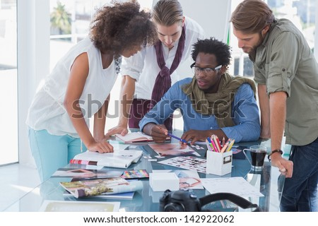 Team of photo editors having brainstorming session in their office - stock photo