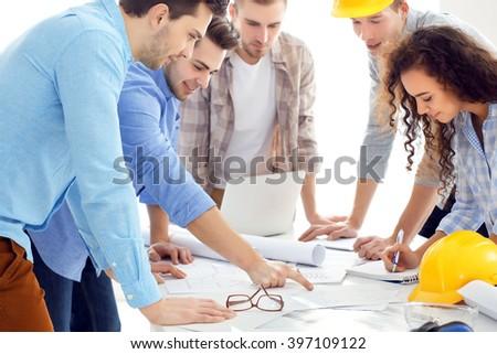 Team of professional engineers - stock photo