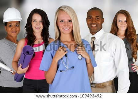 Team of professionals all standing in an office - stock photo
