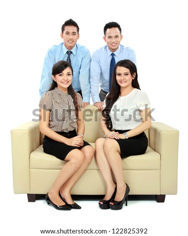 Team of successful business team sitting on the couch isolated over white background