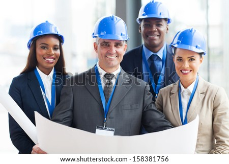 team of successful construction managers in office - stock photo