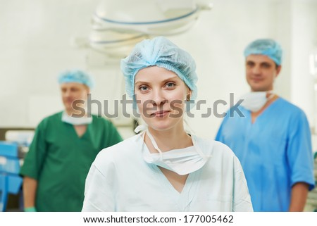 Team of surgeon in uniform after surgery operation at clinic operating room
