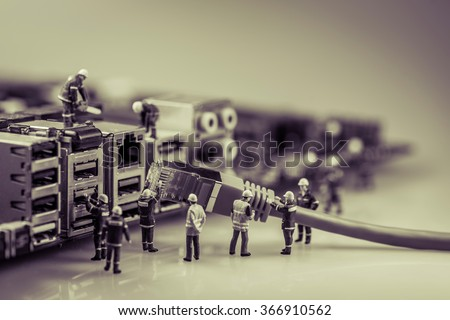 Team of techs connecting network cable. Macro photo - stock photo