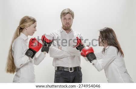 Team of three business people start of furious competition fight, wearing boxing gloves, isolated  on white - stock photo