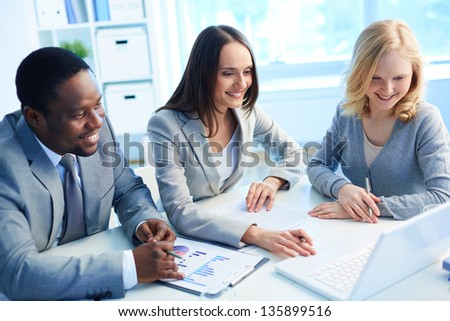 Team of three considering optimal business solution - stock photo