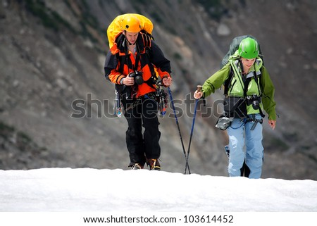 Team of two alpinists crossing Mer de Glace, Haute Savoie, France - stock photo