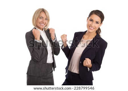 Team of two isolated business woman celebrating her success talking with hands and have fun. - stock photo