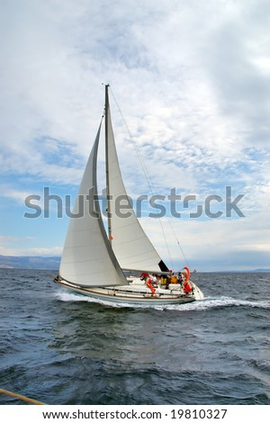 Team on a sailing cruise having a perfect weather - stock photo
