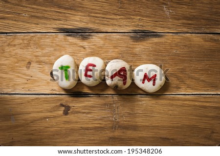 team paint on stone on the wood - stock photo