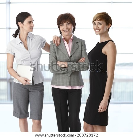 Team portrait of group of businesswomen of diverse age. - stock photo