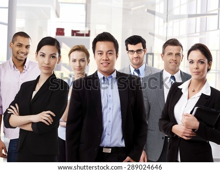 Team portrait of multi ethnic business group at office. - stock photo
