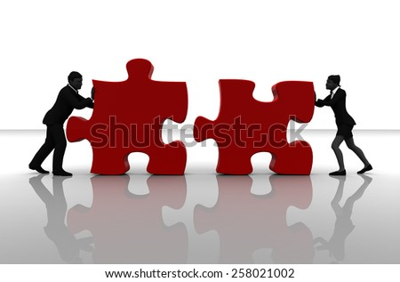 Team pushing jigsaw puzzle pieces. Two executives pushing jigsaw puzzle pieces into position demonstrate teamwork . - stock photo